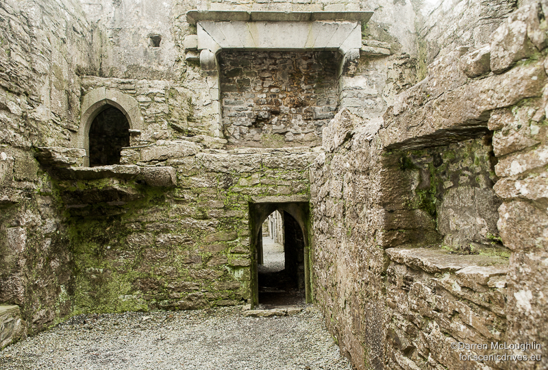 Fireplaces and doorways lead off to other parts of Ross Errilly friary in County Galway